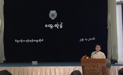 Rangoon Division Chief Minister Phyo Min Thein addresses students and faculty members at Rangoon Univeristy on Monday. (Phyo Min Thein / Facebook)