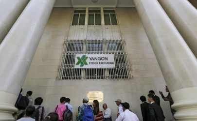People wait at the Yangon Stock Exchange in Rangoon on March 25, 2016. (Photo: Soe Zeya Tun)