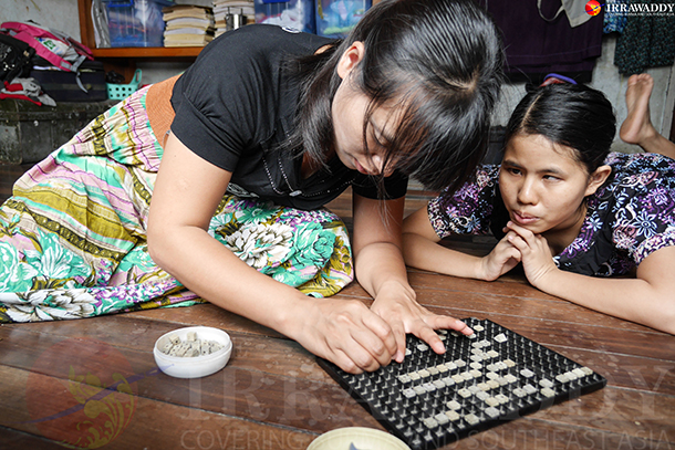 Two students work on a math exercise at the Kawechan School for the Blind in Rangoon. (Photo: Tin Htet Paing / The Irrawaddy)
