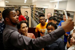 Students take selfies with Burma State Counselor Daw Au…