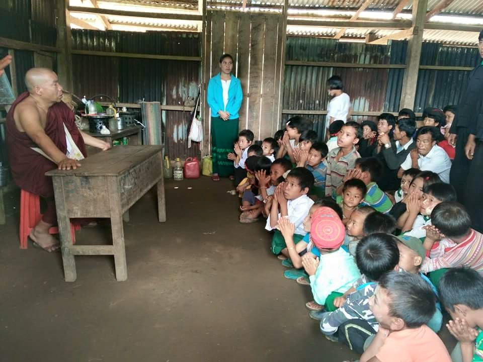 A Ta'ang monk visits a local school in Kutkai Township this year (Photo: Mai Ak Bamh/Facebook)