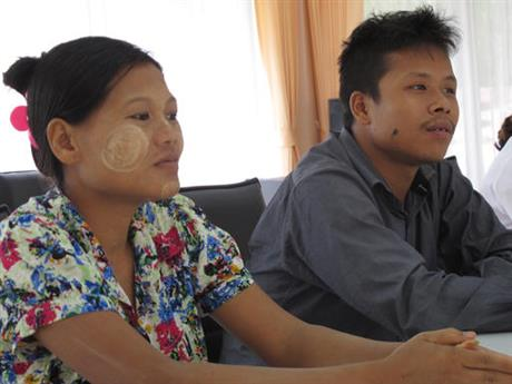 Burmese former shrimp shed worker Tin Nyo Win, right, sits next to his pregnant wife Mi San during an interview in Pathum Thani, Thailand in June 2016 (Photo: Margie Mason / Associated Press)