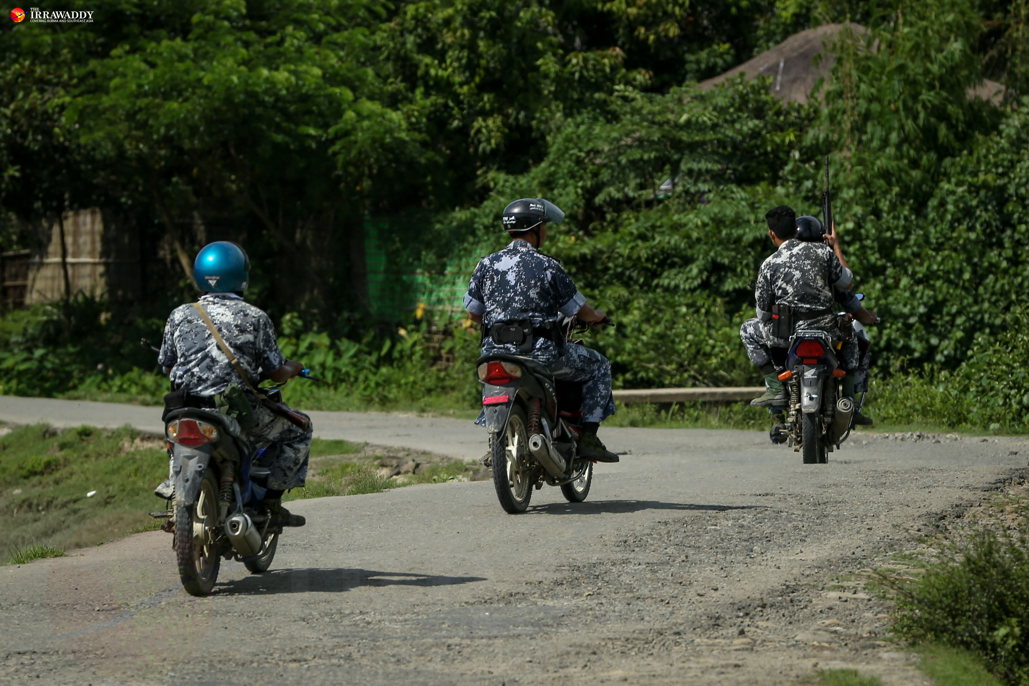 Border Guard Police patrol near Kyikanpyin village, Maungdaw Township. (Photo: Hein Htet / The Irrawaddy)