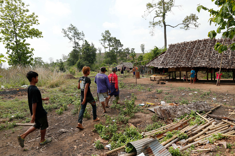 Men walk into a village of displaced Karen exiles called Kyout Sat outside of Mae Sot, Thailand, April 27, 2015. (Derek Gee / Buffalo News)