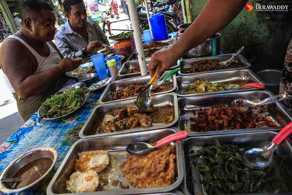 Two men eat street food for lunch in downtown Rangoon. (Photo: J Paing / The Irrawaddy)