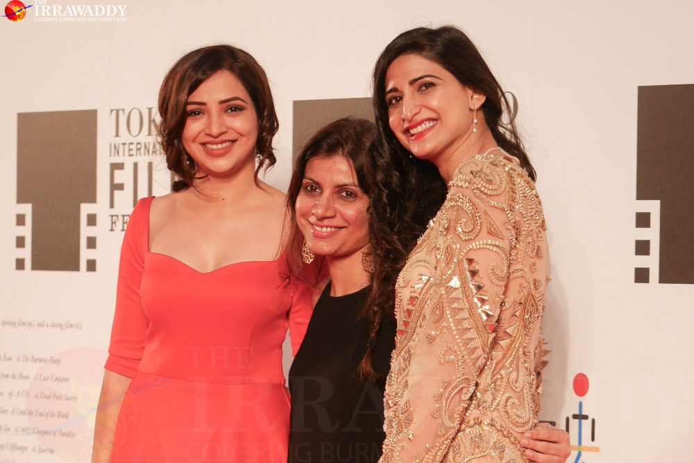 Actress Plabita Borthakur (L), director Alankrita Shrivastava (C) and actress Ahana Kumra (R) appear on the red carpet at the Tokyo International Film Festival opening night. (Photo: Tin Htet Paing / The Irrawaddy)