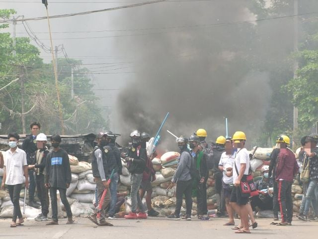 The anti-regime protest is attacked by security forces in Yangon's South Dagon Township on Sunday
